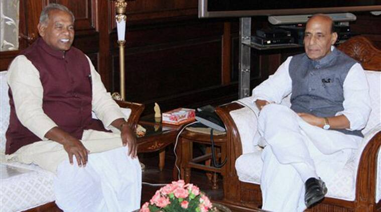 Union Home Minister Rajnath Singh with Chief Minister of Bihar Jitan Ram Manjhi at a meeting in New Delhi on Monday. (Source: PTI)