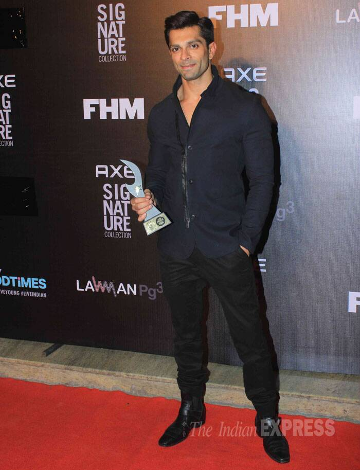 Karan Singh Grover, who will be making his debut in Bollywood opposite Bipasha Basu in Alone', poses with his trophy. (Source: Varinder Chawla)