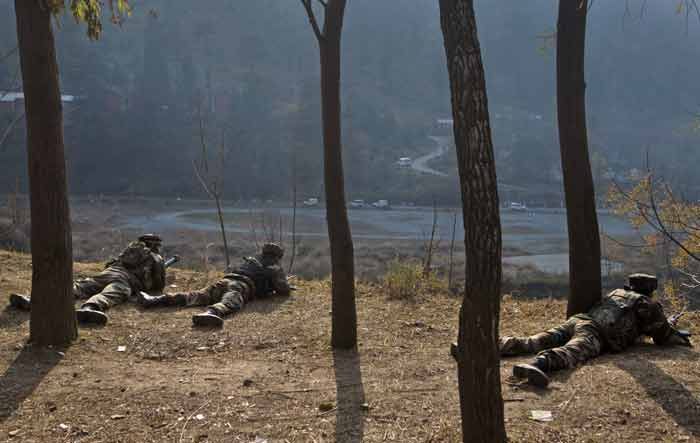 In a daring pre-dawn attack ahead of third phase of elections in Jammu and Kashmir on December 9, heavily armed militants killed 8 Army men and three policemen around 3.10 AM at the camp in Mohra in Uri tehsil of north Kashmir's Baramulla district. (Source: AP)