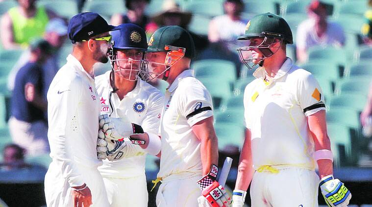 David Warner attempts to play mediator as Virat Kohli and Steve Smith engage in an exchange of words on Day Four of the Adelaide Test. (Source: AP)