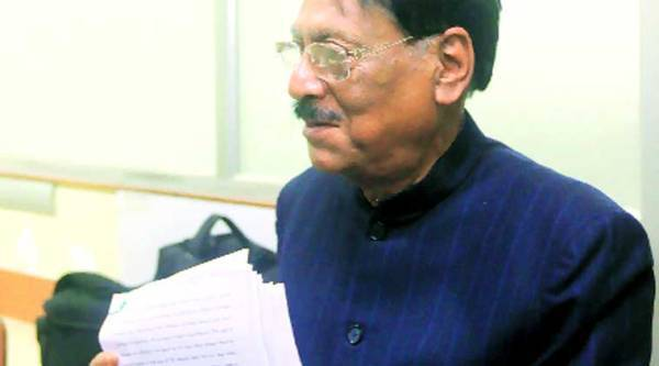 Justice (retd) Sushanta Chatterjee displays the report in Kolkata on Monday. ( Source: Express photo by Partha Paul)