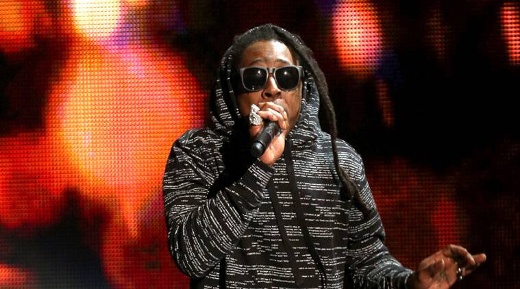 Lil Wayne assures his fans that he will release Tha Carter V soon. (Source: AP)