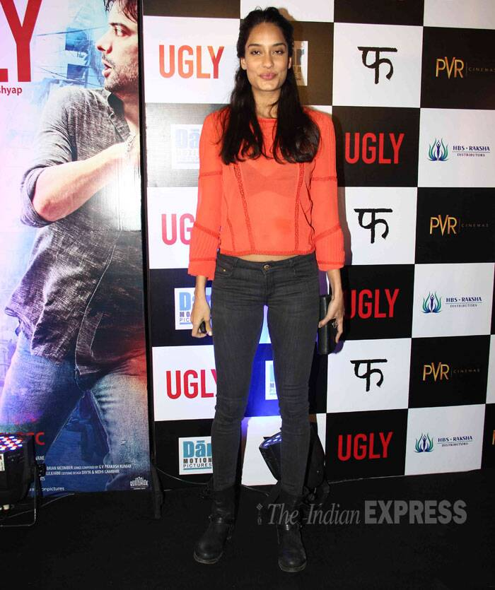 'Queen' actress Lisa Haydon is smart in orange top and black jeans worn with boots. (Source: Varinder Chawla)