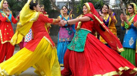 College girls dancing to celebrate Lohri Festival.