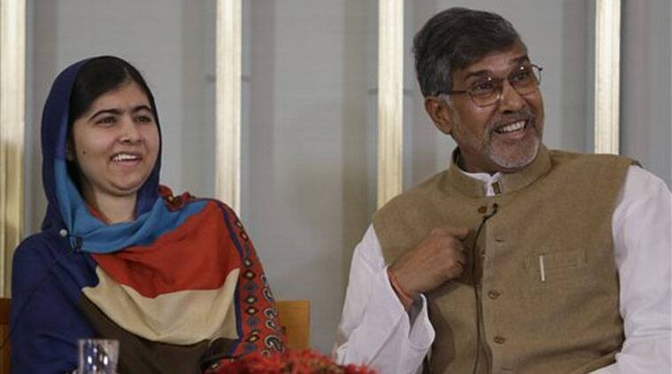 Joint-Nobel Peace prize winners Malala Yousafzai, left, and Kailash Satyarthi attend a press conference in Oslo, Norway. (Source: AP photo)