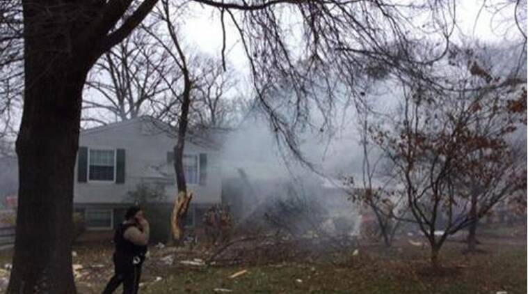 Smoke is seen after a small plane crashed in to a home and damaged others in Gaithersburg, Maryland, in this handout photo provided by the Montgomery County Fire & Rescue Service, December 8, 2014. (Source: Reuters)