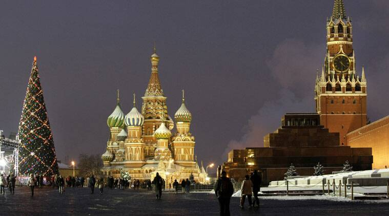 In this Thursday, Dec. 10, 2009 file photo people walk past a huge Christmas tree installed in Red Square, with St. Basil Cathedral. (Source: AP Photo/Misha Japaridze, File)
