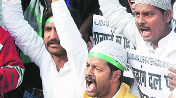 All India Majlis-e-Ittehad-ul-Muslimeen members protest against mass conversion in Lucknow, Friday.