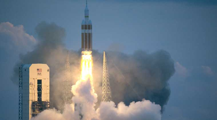 The unmanned spacecraft soared into space at 7:05 am (0535 IST) atop a United Launch Alliance Delta IV Heavy rocket that rumbled and roared as it climbed into pastel skies over the Florida coast at sunrise, leaving a plume of smoke in its wake. (Source: AP photo)