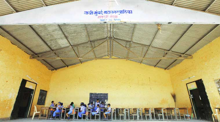 As their school building is under renovation, students of a Navi Mumbai municipal school attend classes at a nearby hall. (Source: Express photo by Narendra Vaskar)