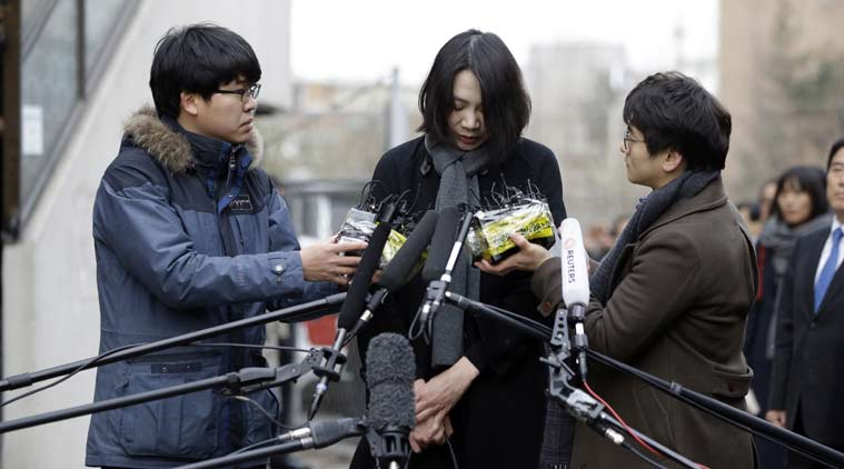 FILE - In this Friday, Dec. 12, 2014 file photo, Cho Hyun-ah, who was head of cabin service at Korean Air and the oldest child of Korean Air chairman Cho Yang-ho, speaks to the media upon her arrival for questioning at the Aviation and Railway Accident Investigation Board office of Ministry of Land, Infrastructure and Transport in Seoul, South Korea. (Source: AP)
