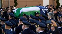 Slain NYPD officer mourned at funeral, fellow officers protest against mayor