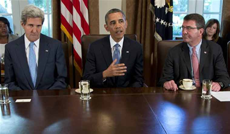 Carter has emerged as President Barack Obama's top candidate to become the next defense secretary. From left to right: John Kerry, Barack Obama, Ashton Carter) Source: AP)
