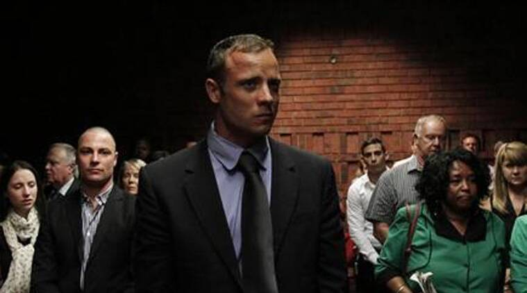 Oscar Pistorius awaits the start of court proceedings in the Pretoria Magistrates court February 19, 2013.  (Source: Reuters)