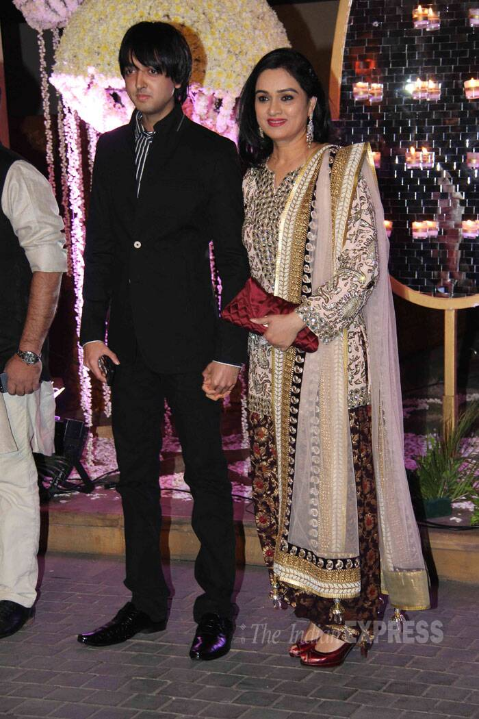 Veteran actress Padmini Kolhapure was seen arriving at ace designer Manish Malhotra's niece Rridhi Malhotra's wedding reception with her teenage son Priyank Sharma. Her son surely has inherited the looks from his beautiful mother. (Source: Varinder Chawla)