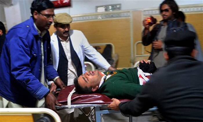 Hospital staff transport a student injured in the shootout at a school under attack by Taliban gunmen in Peshawar, Pakistan,Tuesday, Dec. 16, 2014.  (Source: AP)