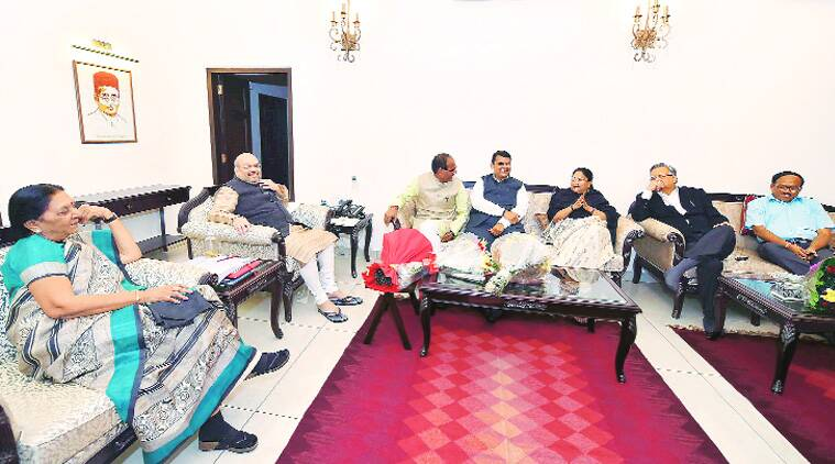 BJP president Amit Shah with chief ministers of BJP-ruled states at his residence after the PM-CMs' meet, in New Delhi on Sunday. (Source: PTI photo)
