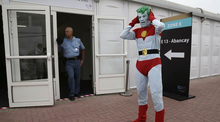 A man dressed as the superhero Captain Planet stands outside a conference room used by the Climate Change Conference in Lima, Peru. (Source: AP)