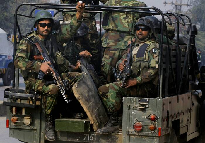 Pakistani army troops arrive to conduct an operation at a school under attack by Taliban gunmen in Peshawar, Pakistan, Tuesday, Dec. 16, 2014. (Source: Reuters)