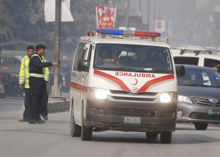 An ambulance drives away from the Army Public School that in under attack by Taliban gunmen in Peshawar, December 16, 2014. (Source: Reuters)