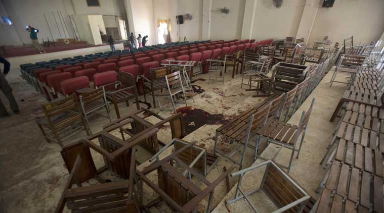 Chairs are upturned and blood stains the floor at the Army Public School auditorium the day after Taliban gunmen stormed the school in Peshawar, Pakistan. (Source: AP)