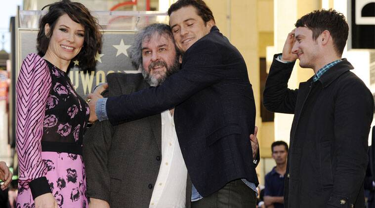 Peter Jackson supported by his wife Fran Walsh and stars like Andy Serkis, Orlando Bloom and Elijah Wood. (Source: AP)