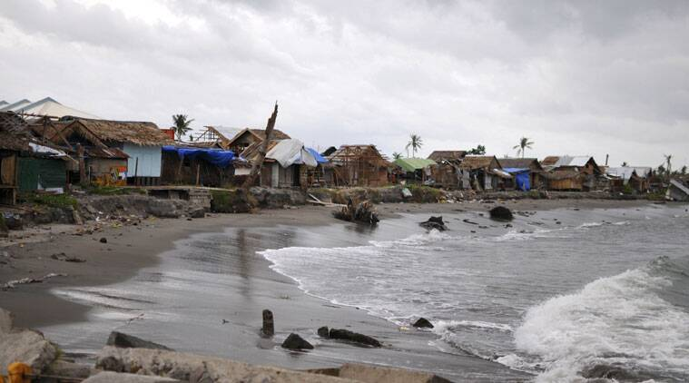 A coastal village in central Philippines, shows abandoned houses as residents take shelter at evacuation centers. (Source: AP photo)