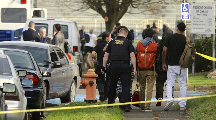 Police guide students from Rosemary Anderson High School following a shooting at the school, in Portland, Oregon. (Source: AP photo)