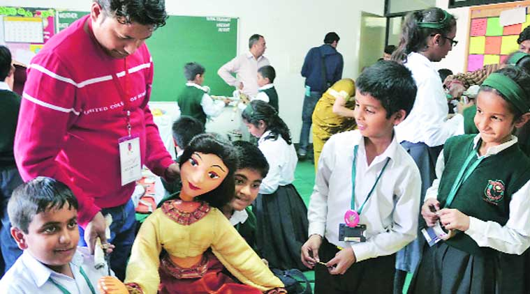 Students of Delhi Public School during the puppet making workshop. (Source: Express photo by Gurmeet Singh)