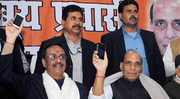 Union Home Minister Rajnath Singh with the Mayor of Lucknow Dinesh Sharma at a function organised for membership to the party, at Madhav Sabhagar in Lucknow on Saturday. (PTI Photo)