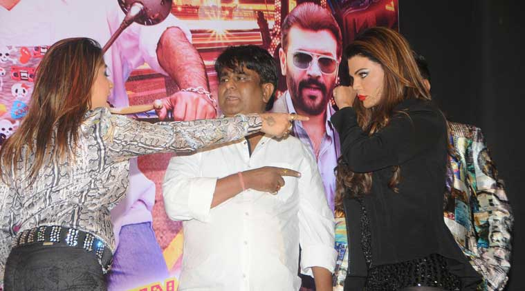 "A friend of Bollywood actress and item girl Rakhi Sawant has publicly slapped Sachendra Sharma, the director of ""Mumbai Can Dance Saala"", accusing him of demanding ""favours"" from her. The director has refuted the claim, terming it as a ""publicity stunt""."