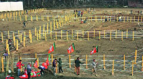 BJP workers make preparations for PM Narendra Modi's rally at Sher-i-Kashmir Stadium in Srinagar on Saturday. (Source: Express photo by Shuaib Masood)