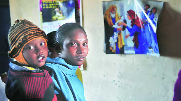 A woman convert with her child at Atiya church. (Source: Express photo by Prashant Ravi)
