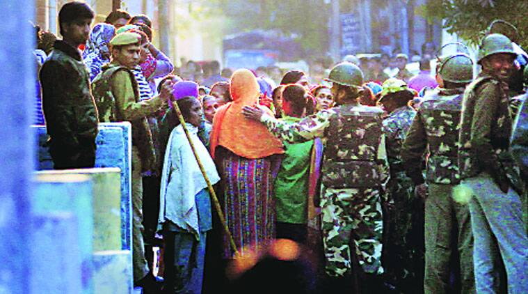 Residents demanded that one of the two houses of the accused be handed over to the victim's family as compensation. (Source: Express photo by Praveen Khanna)