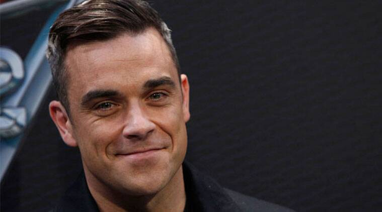 Singer Robbie Williams says he will give up his music career to become a mechanic. (Source: Reuters)
