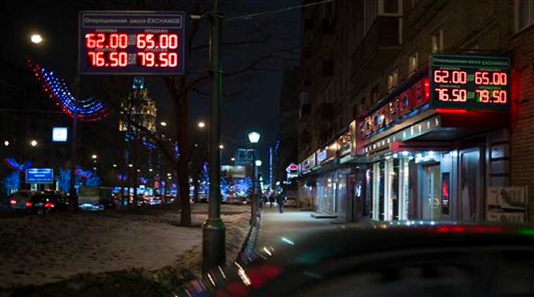 Signs advertising currencies light next to the exchange office in Moscow, Russia, Monday, Dec. 15, 2014.  (Source:AP)