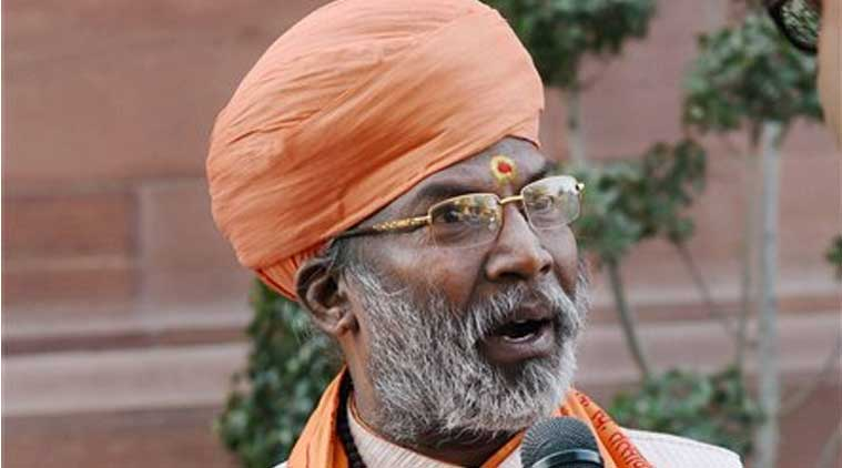 BJP member Sakshi Maharaj talks to the media during the winter session of the Parliament in New Delhi on Thursday. (Source: PTI)