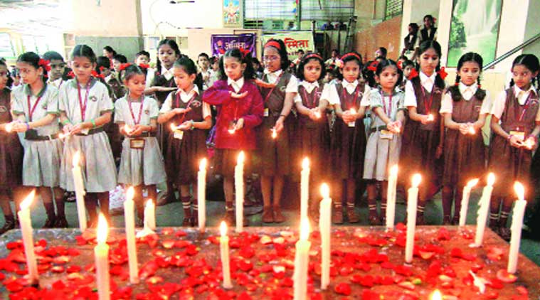 Students of a school in Jogeshwari on Wednesday mourn the death of more than 130 children of a Peshawar school who were killed by terrorists the previous day. (Source: Express photo by Amit Chakravarty)