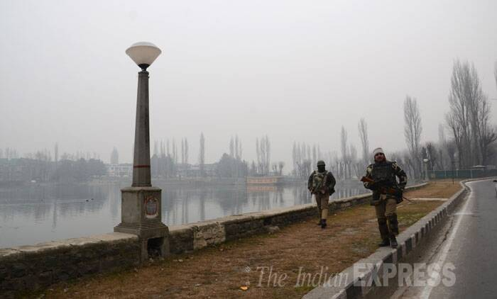Security personnel patrolling outside a polling booth near Dal Lake in Srinagar. (Source: Express photo by Shuaib Masoodi)