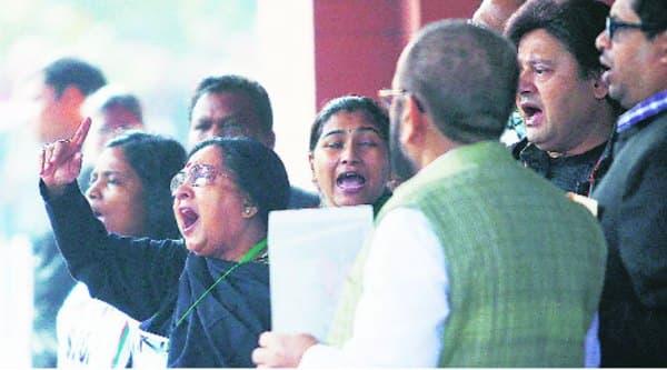 TMC MPs protest outside Parliament House.