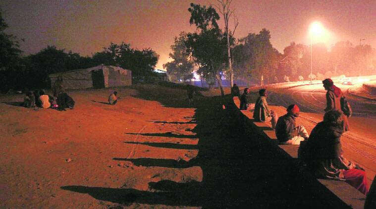 People outside night shelters near ISBT in Kashmere Gate. Some said they would rather be cold than step inside the filthy tents. (Source: Express photo by Praveen Khanna)