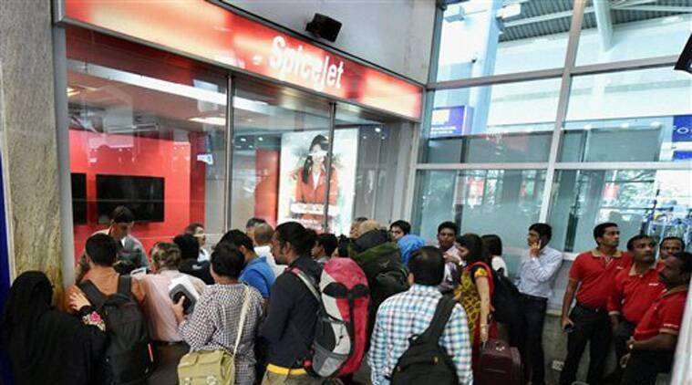 Passengers gather outside a SpiceJet booking counter at Mumbai domestic airport seeking for refunds and status about their canceled flights on Wednesday. (Source: PTI)