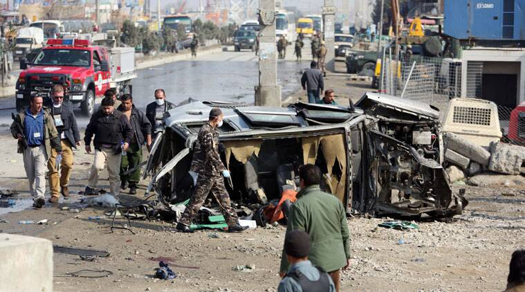 Afghan security forces inspect a British embassy vehicle which was targeted in a suicide attack in Kabul, Afghanistan, Thursday, Nov. 27, 2014. A suicide bomber attacked a British embassy vehicle in the Afghan capital Kabul on Thursday, killing several Afghan civilians and wounding more than 30 others, officials said. An embassy spokesman confirmed the attack and said some people in the vehicle were wounded, without providing further details. He added that the vehicle was not carrying any British diplomats. (Source: AP Photo/Rahmat Gul)