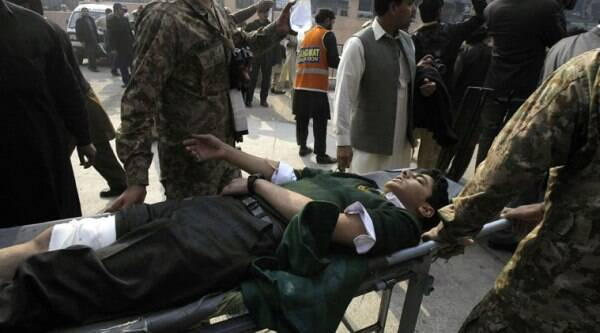 A Pakistani student, who was injured in a Taliban attack in a school, is wheeled into a hospital in Peshawar, Pakistan on December 16. (Source: AP)