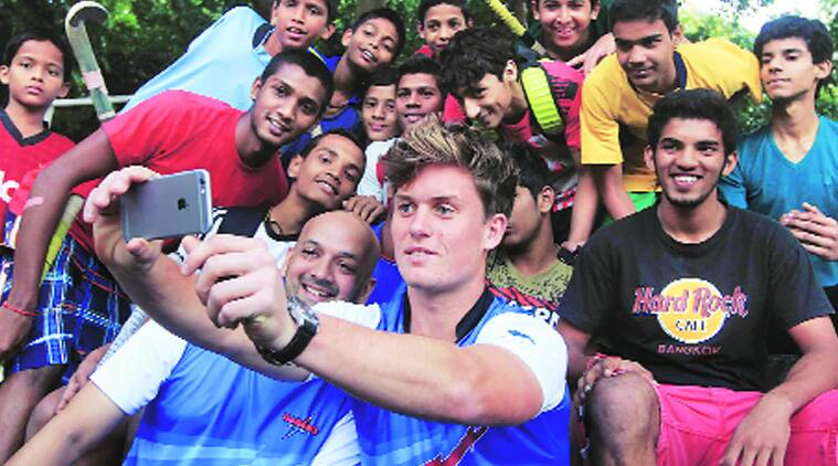 Tom Boon takes a selfie alongside Viren Rasquinha in Mumbai.