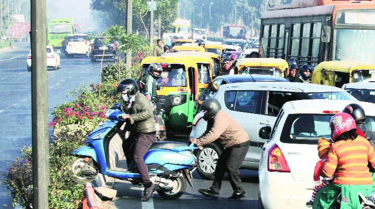 Breaking all barriers: Commuters try to a way out of a traffic jam on Nizamuddin Bridge. (Source: Express photo by Prem Nath Pandey)