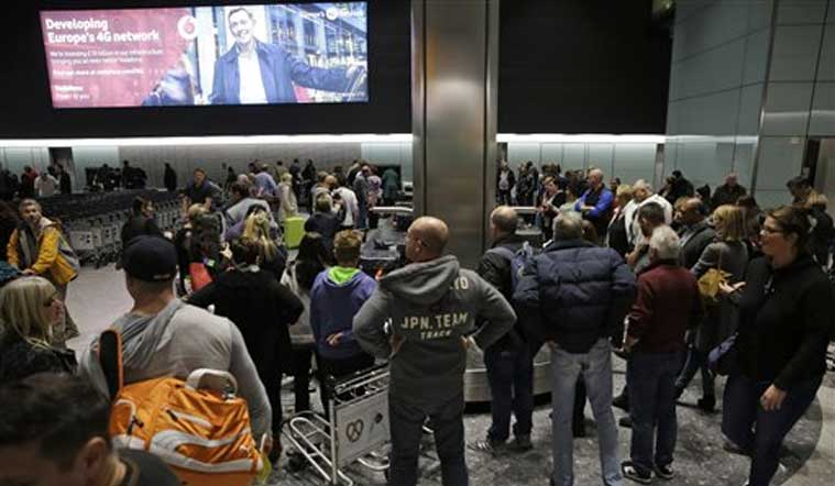 People wait, in the luggage hall of Terminal 5 at Heathrow Airport in London, Friday, Dec. 12, 2014. (Source: AP)