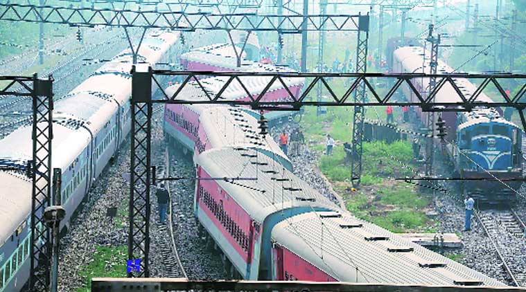 Derailed coaches of Delhi-bound Poorva Express at Lilua Station on Sunday morning. (Source: Express Photo)