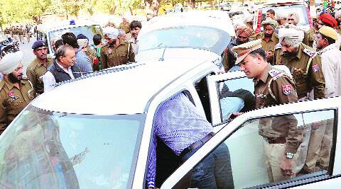 Police search the recovered car on Sunday. (Source: Express photo)