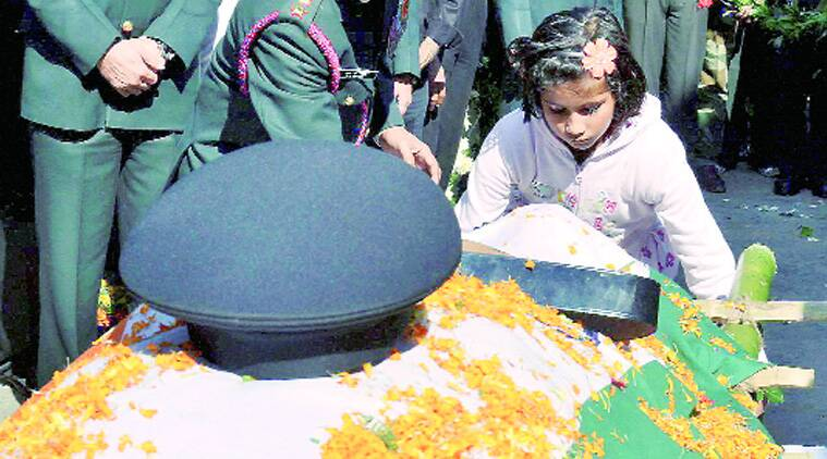 Daughter of Lt Colonel Sankalp Kumar pays tribute to him in Ranchi on Sunday. (Source: PTI photo)